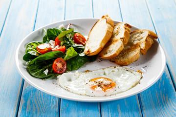 Breakfast - fried egg ,toasts and vegetabla salad