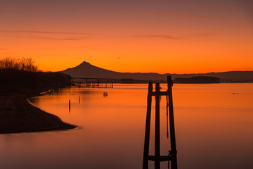 Orange glowing pre sunrise colors over the Columbia River and Mt Hood