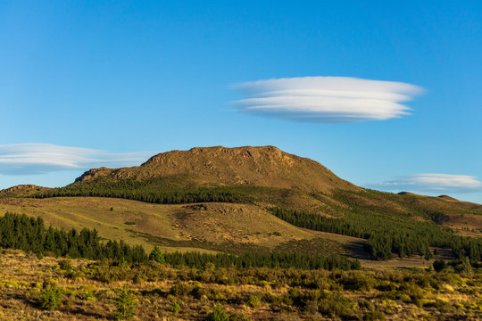 Andes mountain range against lenticular clouds in the sky