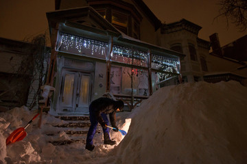 Man digs fort in the snow during a winter storm in Buffalo, New York
