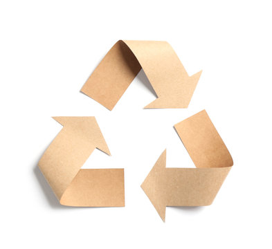 Recycling symbol cut out of kraft paper on white background, top view