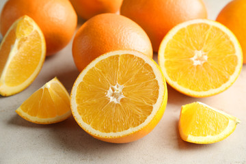 Fresh juicy oranges on light table, closeup
