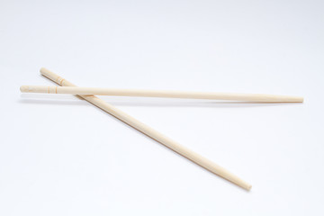 Chinese sticks on a gray background. View from above