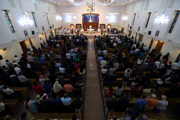 Worshippers attend their Friday evening mass at Sacred Heart Catholic Church in Manama