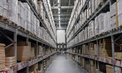 Warehouse with boxes on shelves and racks.