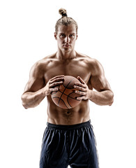 Muscular man with a basketball is preparing to throw. Photo of young man on white background. Strength and motivation