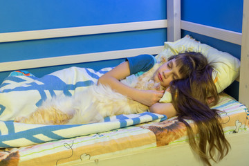 Girl falls asleep with a fluffy cat