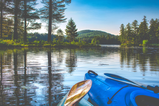 kayaking in the lake with friends - vermont