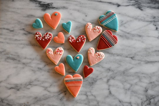 Small heart shaped cookies arranged to form a large heart