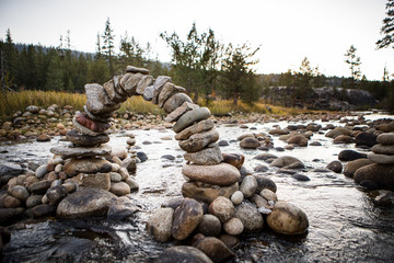 Miniature stone arch in the middle of a stream