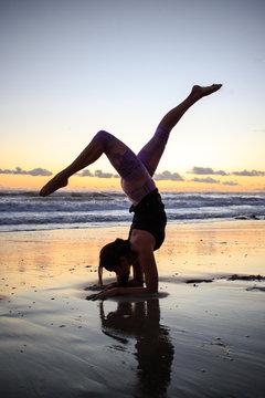 Woman doing a yoga pose on the beach