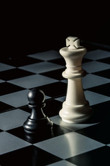 Chess board. White king threatens black opponent's pawn