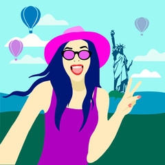 girl in glasses and a hat travels in new york. selfie on the background of the statue of liberty