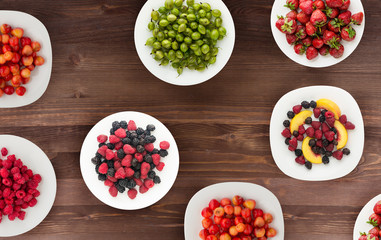 fruits on a plate. vegetarian food on wooden background. vegan food top view