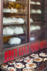 Food stall, steamed pork buns, in Kowloon, Hong Kong, China