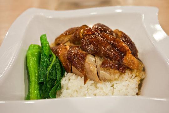 Peking duck with, bok choy, rice at restaurant in Hong Kong, China