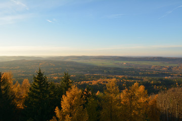 Autumn view from lookout tower Maminka at the top of Krusna Hora near Hudlice, Czech republic.