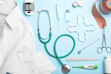 Flat lay composition with medical objects on color background