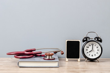 Doctor workspace desk with stethoscope.