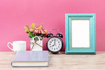 Blank photo frame on desk space.