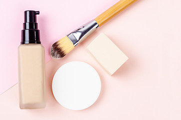 Liquid foundation makeup with brush and sponge.