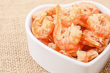 Dried shrimp in white bowl.