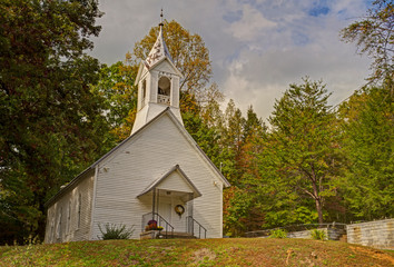 Little white country church at the break of fall.
