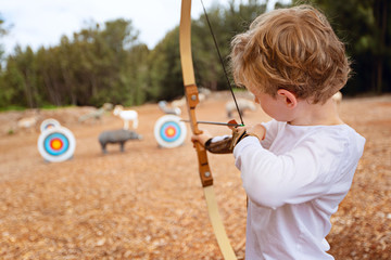 kid practicing archery