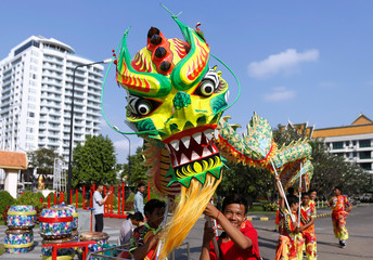 Men perform a dragon dance ahead of the Chinese Lunar New Year in Phnom Penh, Cambodia