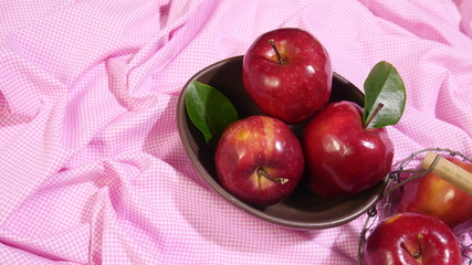 Apple on plate. Photoshoot pink background