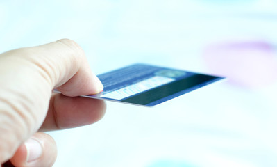 Hand of woman holds her credit card bank pay to shop for her credit card.