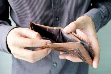 hand of businessman open pocket, no money in the business wallet, Financial concepts and expenditures,