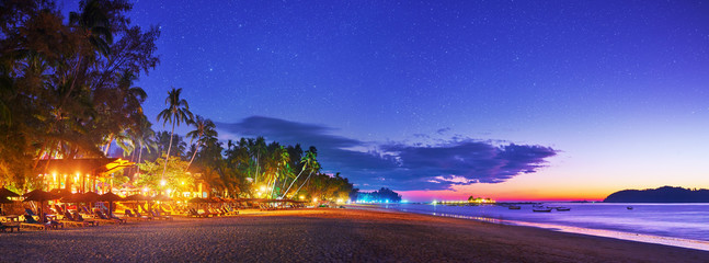 Beautiful evening panoramic view of tropical beach on the resort coast in Ngapali, Myanmar.