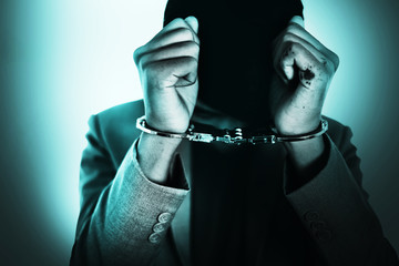 Business Man's hand in handcuff, crime arrested concept