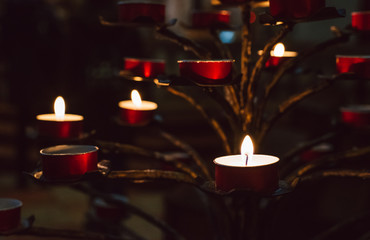 Small fired candles in a church