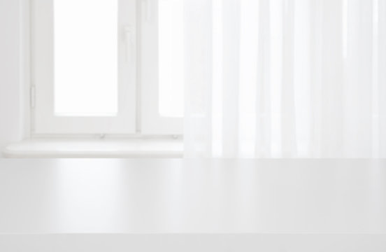 White table top on blurred pastel background of curtained window
