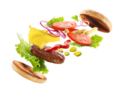 Delicious burger with floating ingredients, isolated on white background