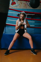 Fitness woman with the white boxing bandages. Attractive Female Boxer Training.