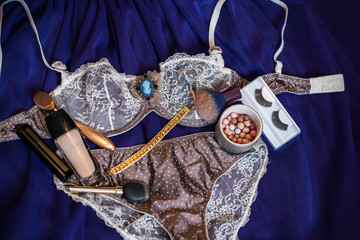 Set of glamorous stylish sexy lace lingerie with woman accessories, beauty products, perfume and cosmetics. Shopping and fashion concept