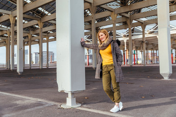 Portrait of blonde girl posing in the city