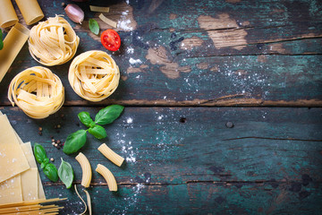 Italian food background with different types of pasta, health or vegetarian concept. Top view with copy space.