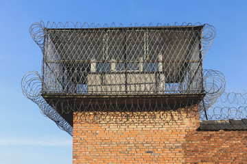 a watchtower secured by barbed wire