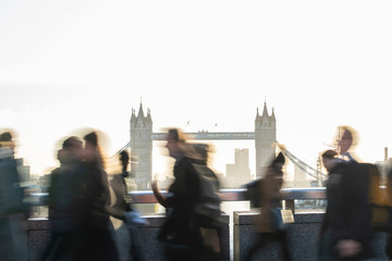 Zelfklevend Fotobehang Centraal Europa CMotion Blur Shot Of Commuters Walking To Work Across London Bridge UK With Tower Bridge In Background