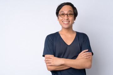 Portrait of happy Japanese man smiling with arms crossed