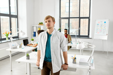 business and people concept - man standing at office table
