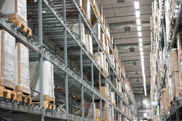 Background of warehouse or storehouse industrial and logistic company.Warehousing on the floor and called the high shelves