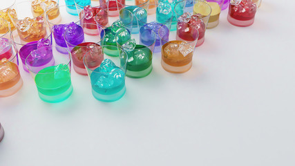 Multi color drink glasses with ice in the corner.