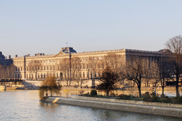 Louvre Palace in front of Seine river - Paris, France
