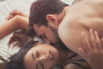 lovers making love having passionate sex on bed, enjoying pleasant sensation,.
