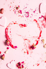 fruit powder and hearts on the pink background
